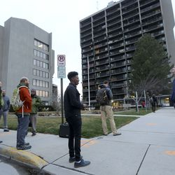 People practice social distancing, due to COVID-19, while being evacuated from the Salt Lake County Government Center in Salt Lake City after a 5.7 magnitude earthquake centered in Magna hit early on Wednesday, March 18, 2020.