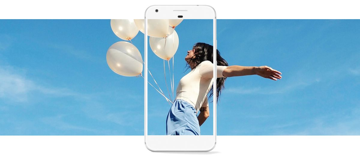 """a woman with her arms spread, holding white balloons, with a blue sky in the background, with a Google Pixel phone superimposed over her, as if it's capturing her in its frame as she cries """"Ermigerrrd, I'm beautiferrr!"""""""