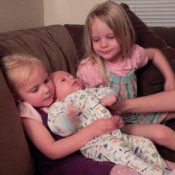 Emilie Parker, right, is seen with her siblings. Emilie, who has family in Utah, was killed along with 19 other children in a mass shooting at an elementary school in Newtown, Conn., Friday, Dec. 14, 2012.