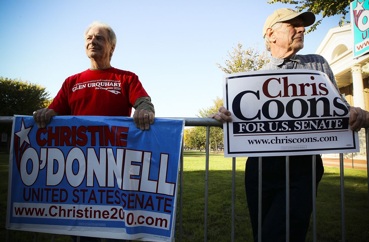 O'Donnell supporter Bill Ward (left) and Coons Supporter Bob Baur hold campaign signs in front of the debate hall at the University of Delaware on October 13, 2010.