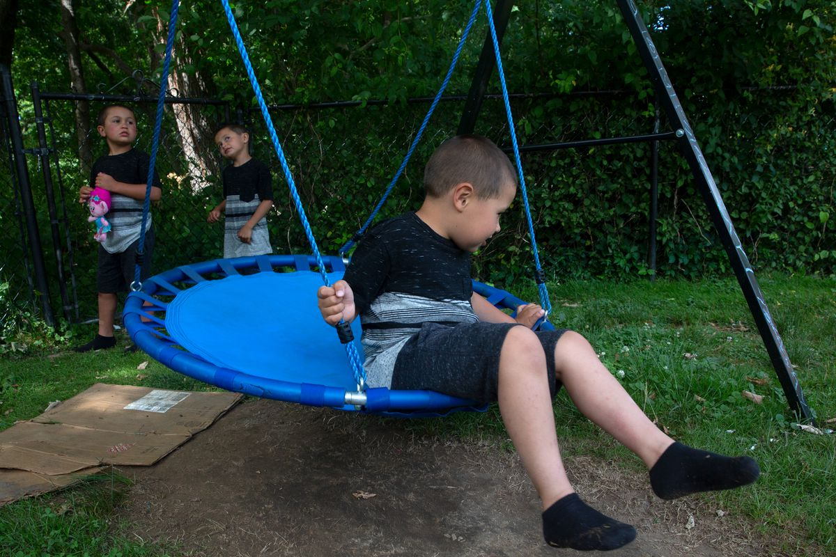 Special needs students Mathew, Danny and Owen Fridman, right to left, play outside their aunt's New Jersey home while struggling with at-home learning during the coronavirus outbreak, June 17, 2020.