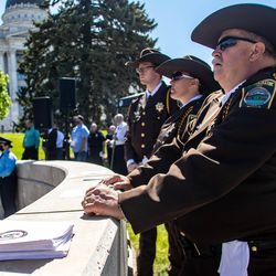 Law enforcement officers with the Box Elder County Sheriff's Office listen during the annual Utah Police Memorial Service at the Utah Capitol on Thursday, May 6, 2021. Utah police officers, family, friends and community leaders gathered for the annual service honoring the 147 Utah police officers killed in the line of duty.