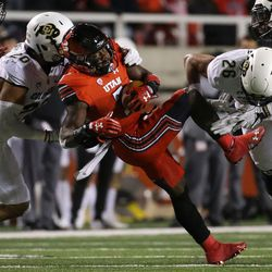 Utah Utes running back Devonta'e Henry-Cole (7) runs the ball during the game against the Colorado Buffaloes at Rice-Eccles Stadium in Salt Lake City on Saturday, Nov. 25, 2017.