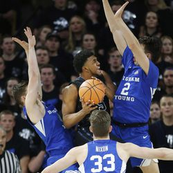 Utah State Aggies guard Julion Pearre (5) is surrounded by Brigham Young Cougars defenders in Logan on Saturday, Dec. 2, 2017.
