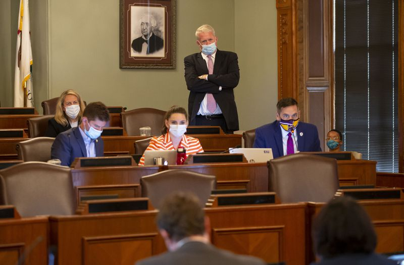 Illinois House Republican Leader Jim Durkin, standing, watches as state Rep. Tim Butler, right, R-Springfield, asks questions during an Illinois House of Representatives Redistricting Committee meeting Tuesday.