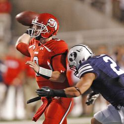 Utah Utes quarterback Jon Hays (9) passes before Brigham Young Cougars linebacker Spencer Hadley (2) hits him during the first half as the University of Utah and BYU play football Saturday, Sept. 15, 2012, in Salt Lake City, Utah.