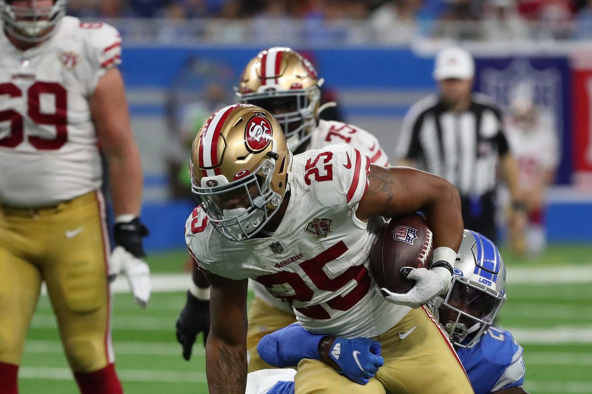 San Francisco 49ers running back Elijah Mitchell (25) runs by Detroit Lions defensive back Tracy Walker III (21) Sunday, Sept. 12, 2021 at Ford Field.