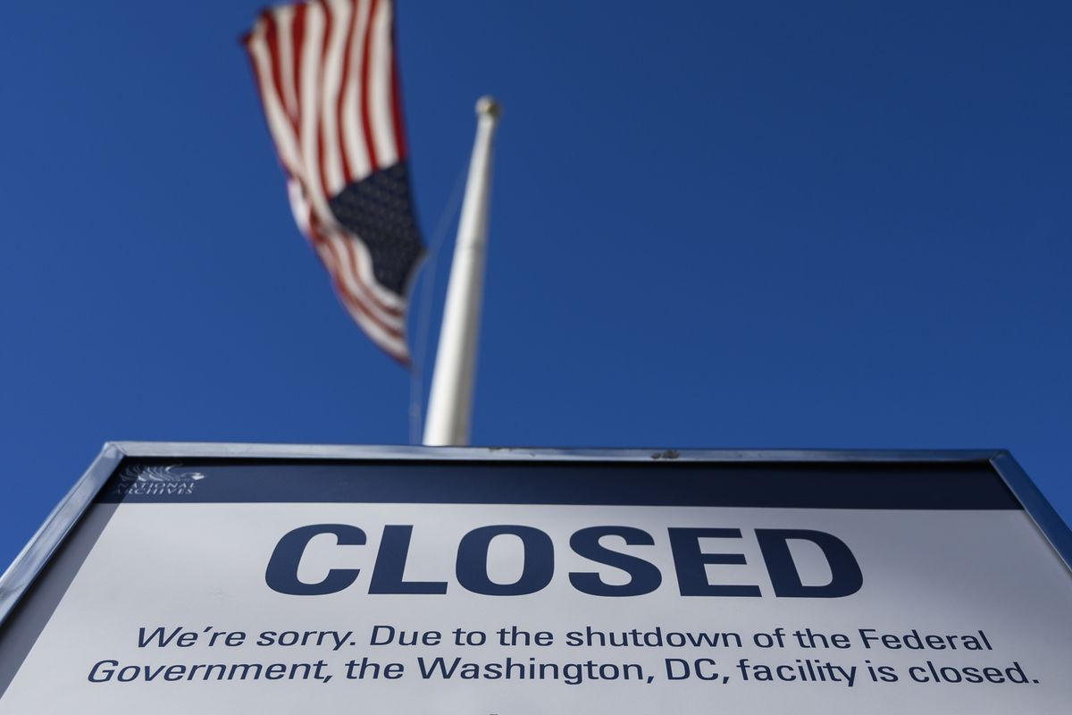 A sign is displayed on a government building that is closed because of a US government shutdown in Washington, DC, on December 22, 2018.