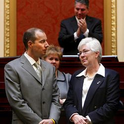 Steve Miller and his mother, Gail, receive a standing ovation in the Utah House chambers at the state Capitol on behalf of the late Larry H. Miller's contributions to Utah.