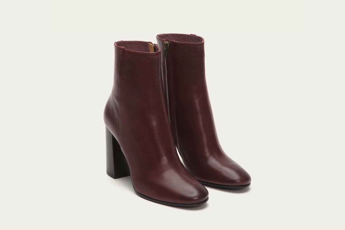 A pair of dark burgundy ankle boots
