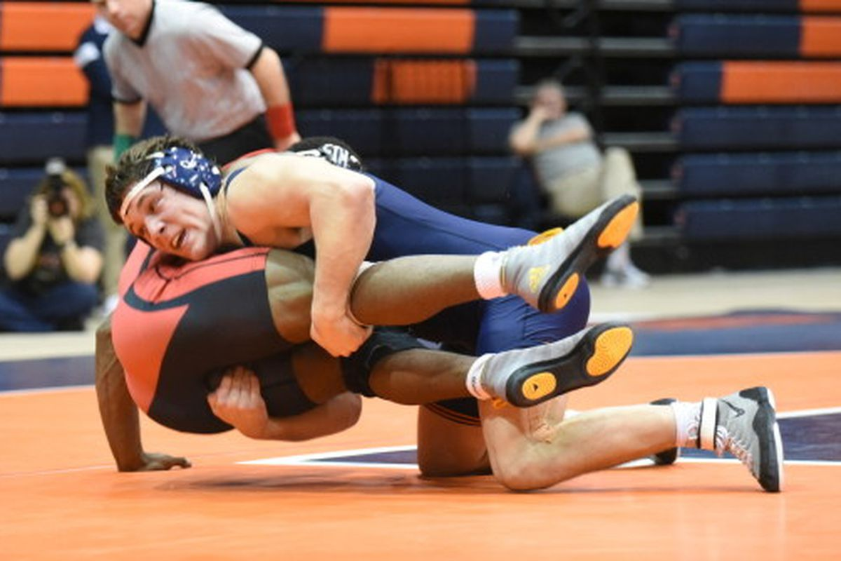 Illinois' Jeff Koepke, right, grabs a takedown against Wisconsin's No. 10 Timmy McCall on Sunday at Huff Hall.