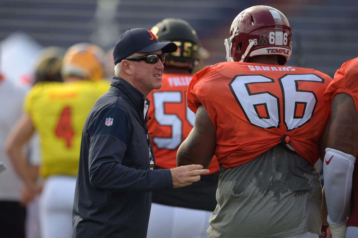 MOBILE, AL - North Team head coach John Fox of the Chicago Bears coaches up Temple offensive lineman Dion Dawkins (66) during Senior Bowl practices at Ladd-Peebles Stadium.