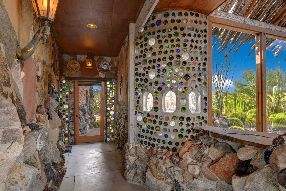 The hallway leading to the master bedroom has jewels and glass set into the walls.