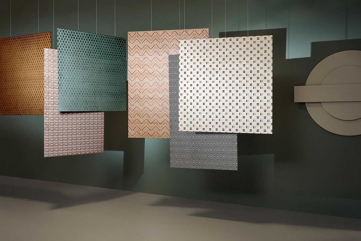 Patterned textiles hanging from ceiling.