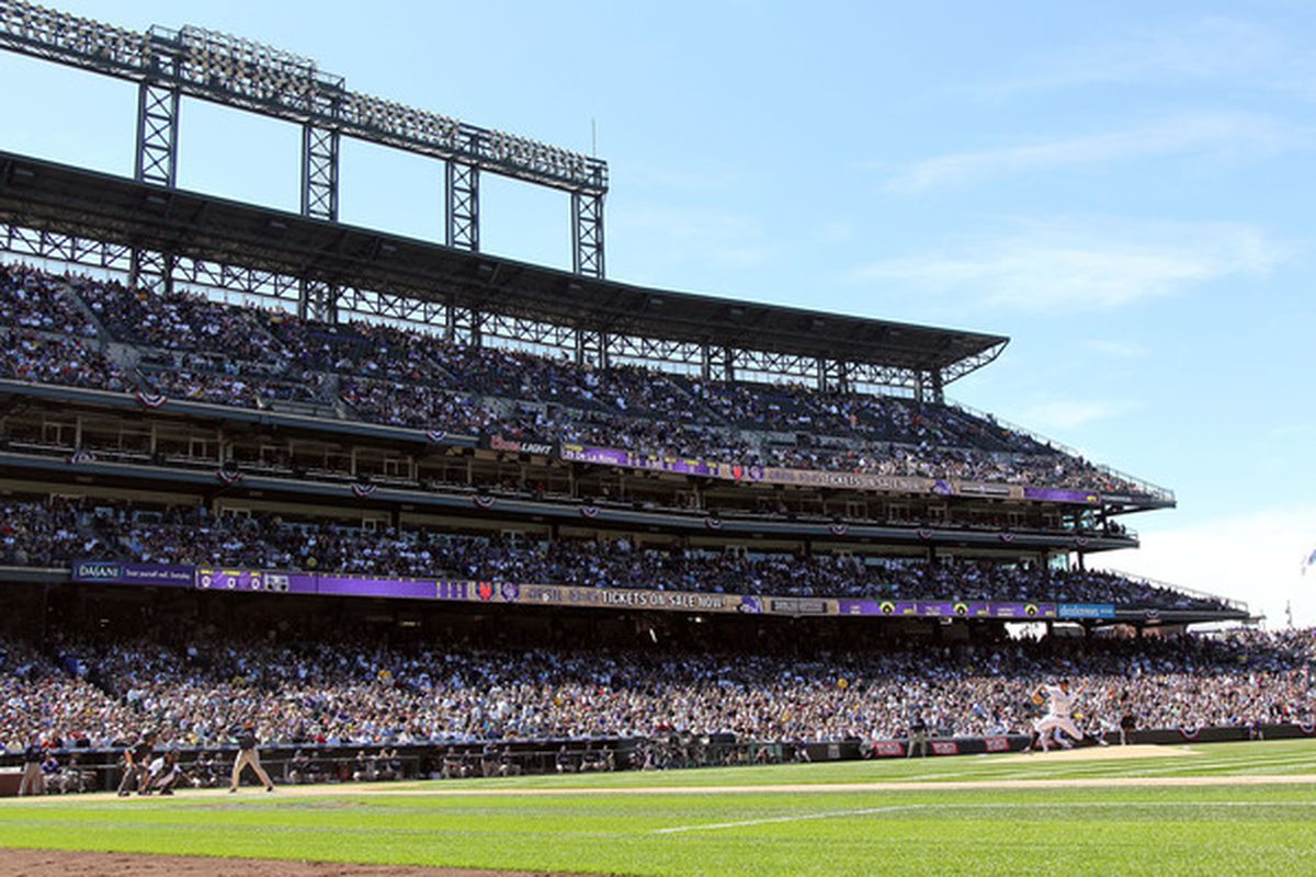 Jorge De La Rosa delivers the first pitch of the Colorado Rockies' 2010 home opener against the San Diego Padres in front of a sellout crowd at Coors Field.