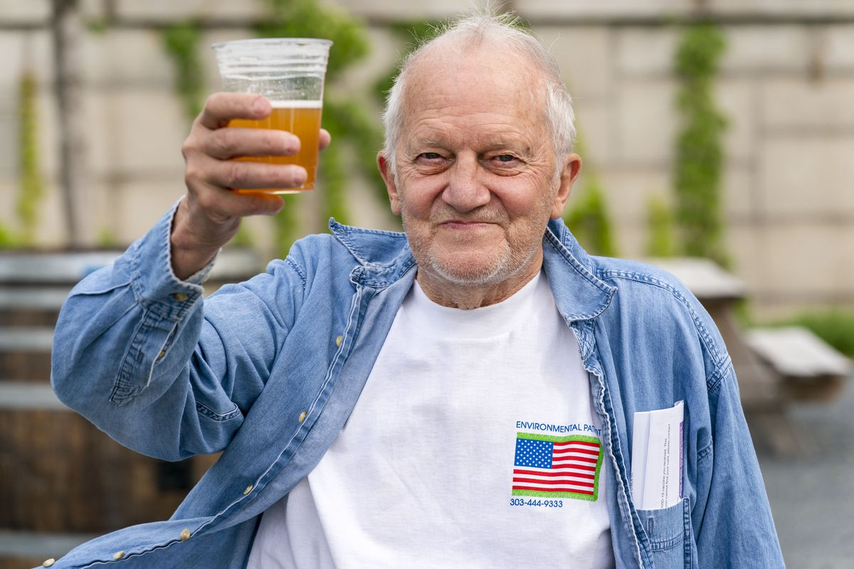 George Ripley, 72, of Washington, holds up his free beer after receiving the J & J COVID-19 vaccine shot earlier this month at the Kennedy Center in Washington.