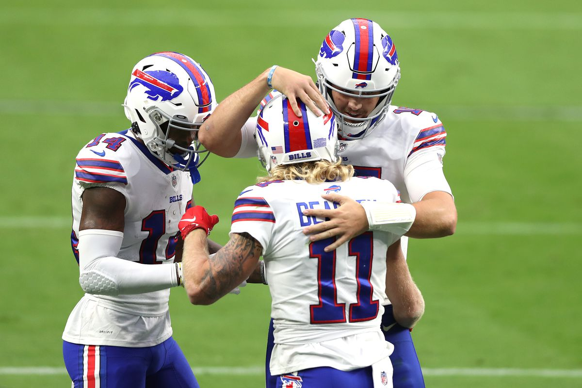 Josh Allen of the Buffalo Bills celebrates with Cole Beasley after throwing an 11- yard touchdown pass against the Las Vegas Raiders during the second quarter in the game at Allegiant Stadium on October 04, 2020 in Las Vegas, Nevada.