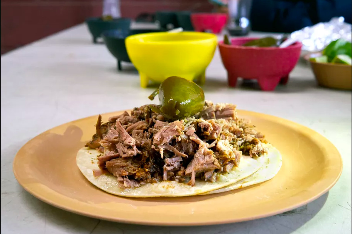 A taco on a yellow plate