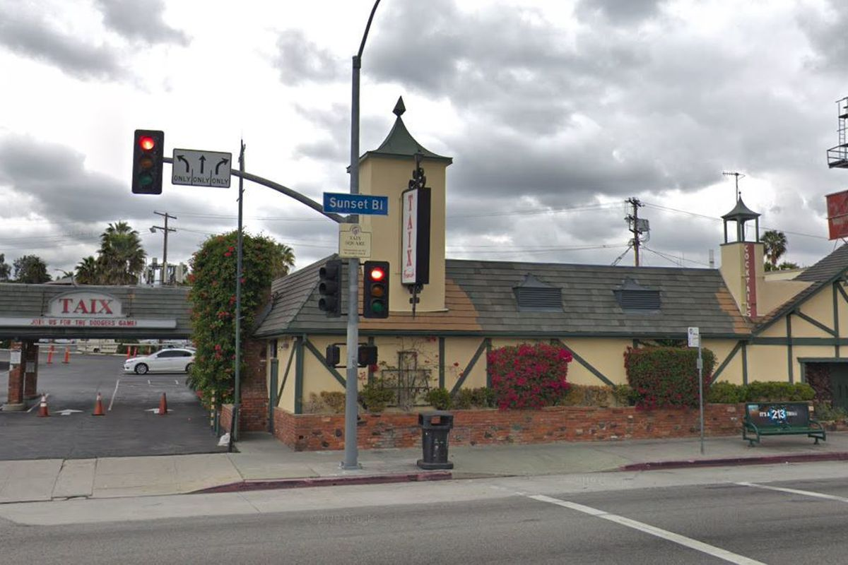 Street view of Taix Restaurant in Echo Park, a single-story building with green roof.