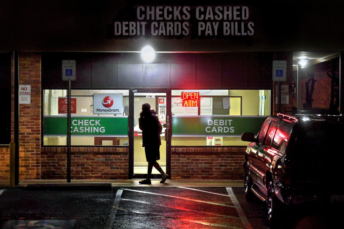 A person leaving a payday loan store.
