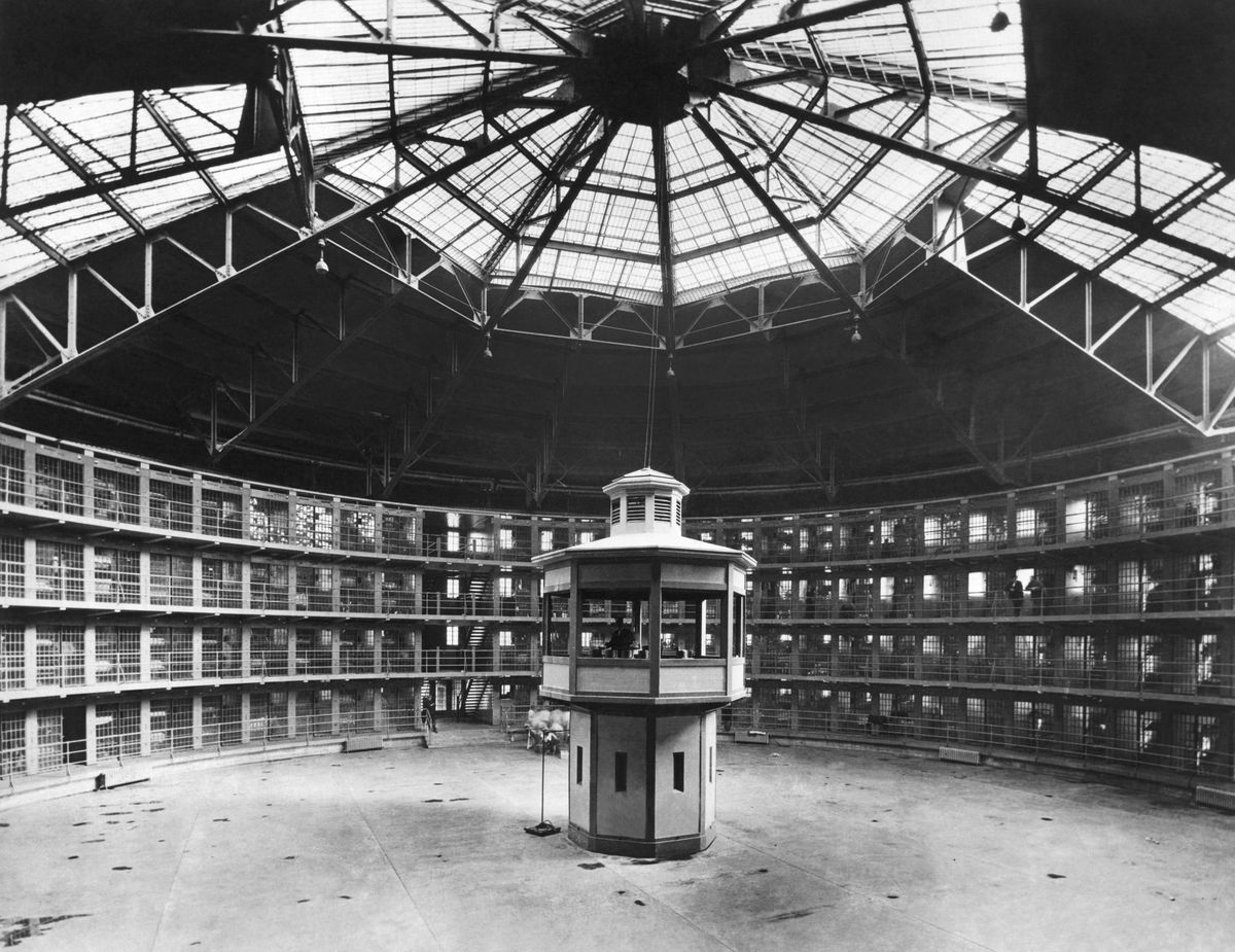 A view of the prison cells surrounding a guard tower at Stateville Correctional Center.