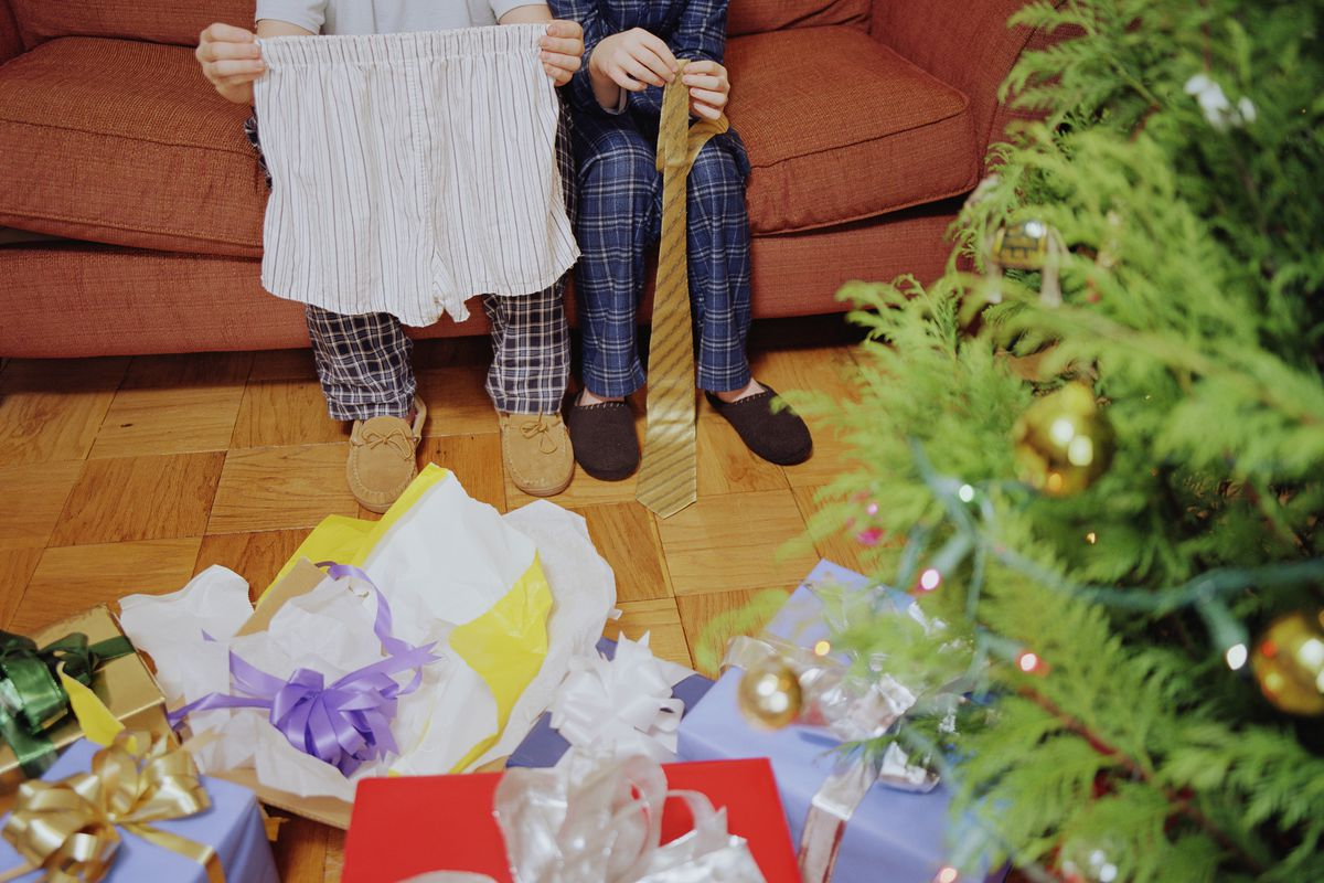Unwrapped presents under a Christmas tree