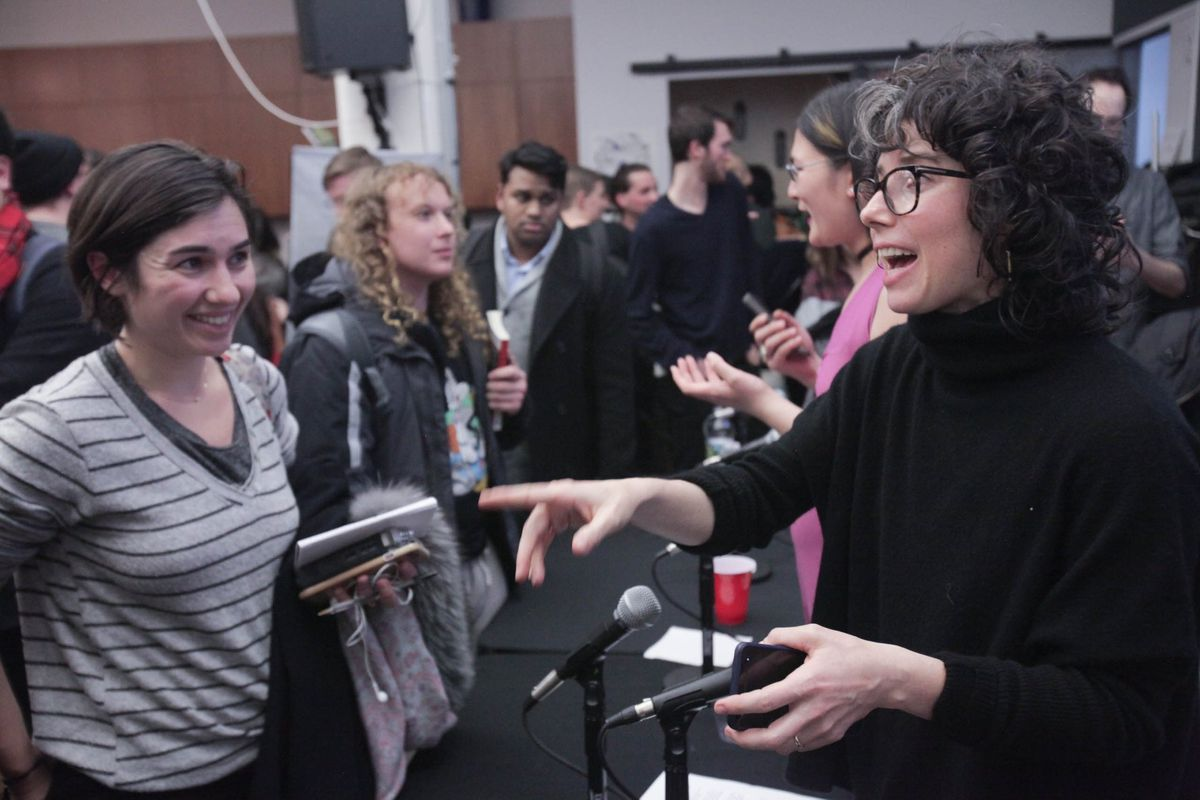 Meredith Whittaker, a Google employee and activist, speaks with an attendee at a panel discussion about tech worker activism.