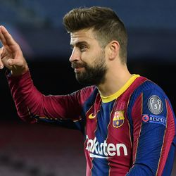 Pique celebrates his goal and Barca's second