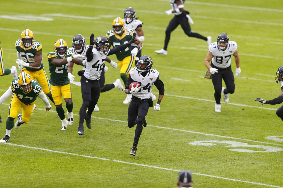 Jacksonville Jaguars wide receiver Keelan Cole Sr. (84) returns a punt for a touchdown against the Green Bay Packers during the second quarter at Lambeau Field.