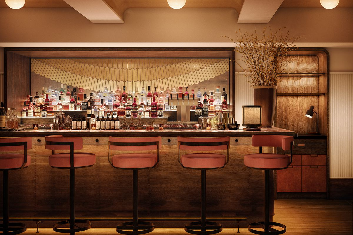 The bar at Evening Bar shows a bar with five stools facing a fully stocked bar of bottles on display. there's a large mirror in the background.The surface of the bar and the floors are wood.
