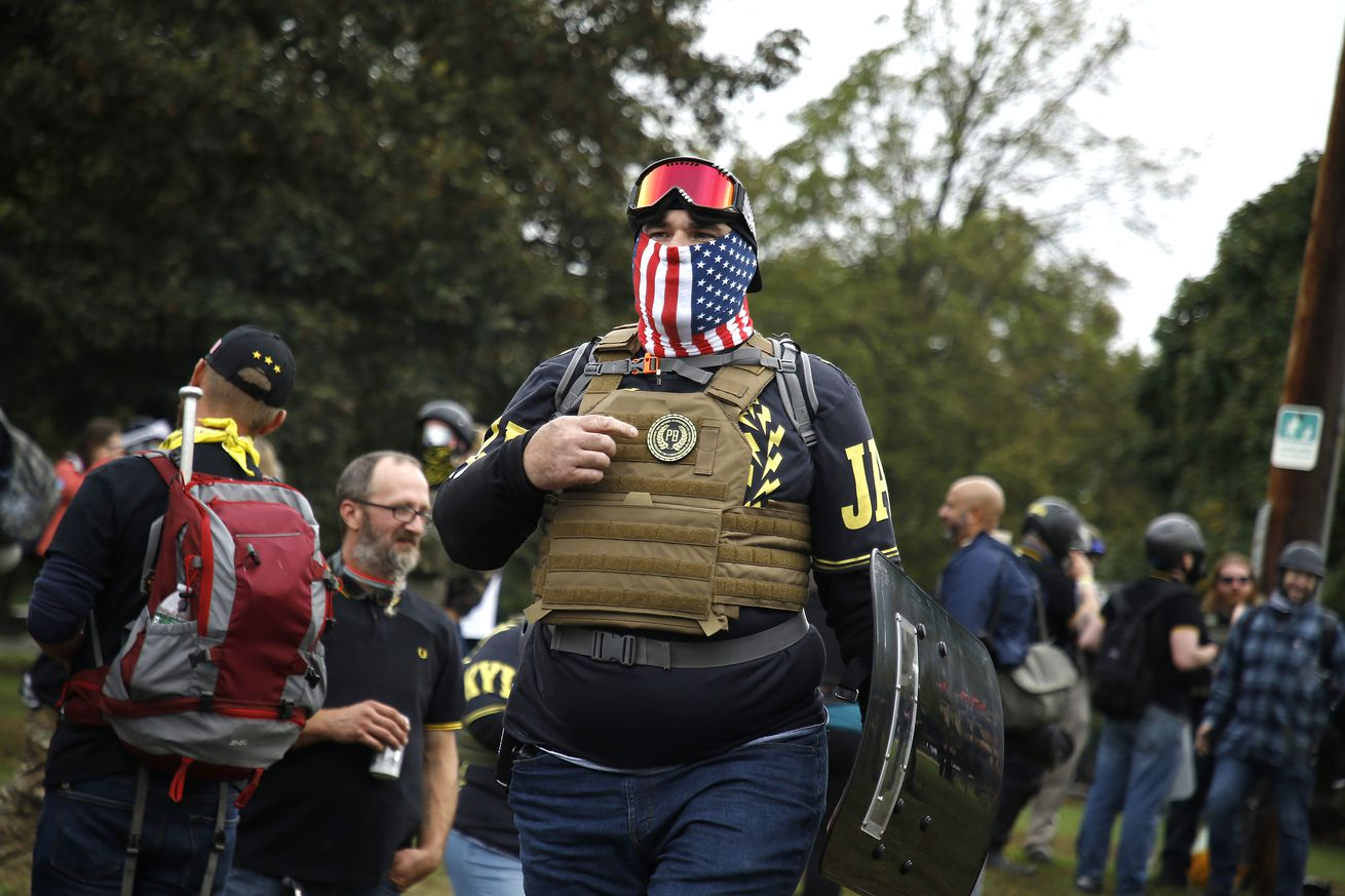 A member of the far-right Proud Boys wearing military gear...