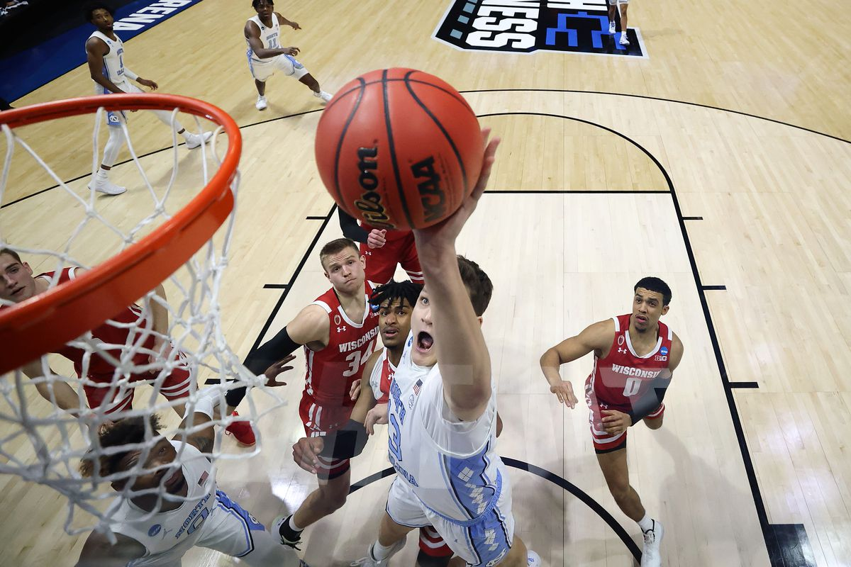 Walker Kessler #13 of the North Carolina Tar Heels drives to the basket during the first half against the Wisconsin Badgers in the first round game of the 2021 NCAA Men's Basketball Tournament at Mackey Arena on March 19, 2021 in West Lafayette, Indiana.