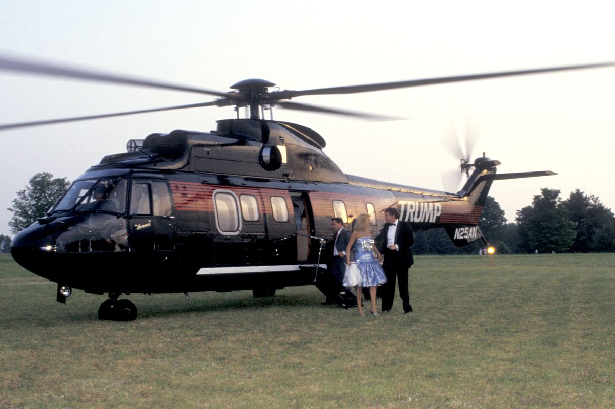 Donald and Ivana Trump, and helicopter, arrive at Forbes' 70th anniversary party.