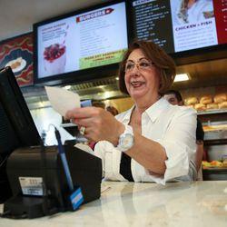 Rula Katzourakis serves customers at Crown Burgers in Salt Lake City on Friday, Aug. 5, 2016. John and Rula Katzourakis have owned and operated Crown Burgers for 38 years.