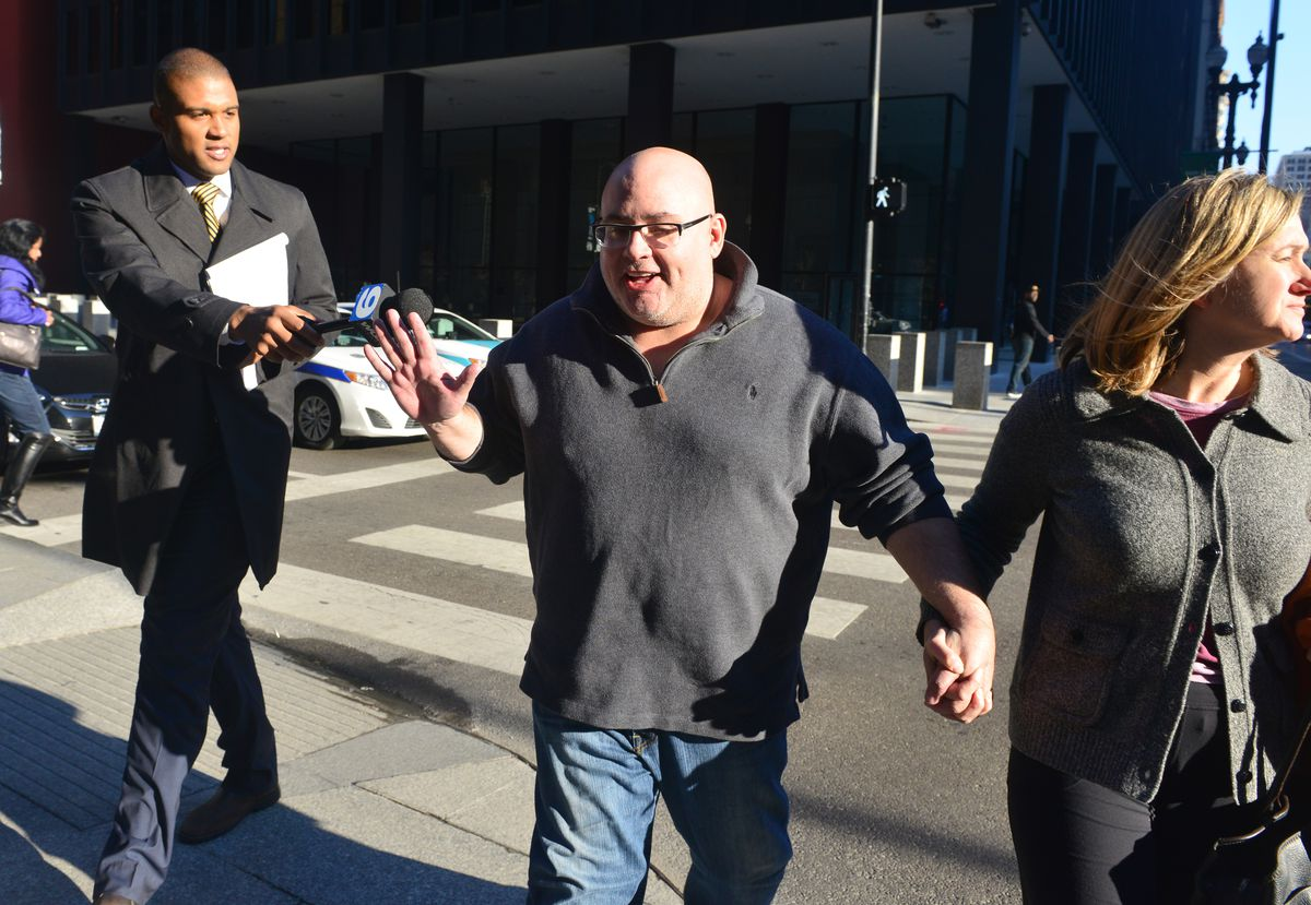 John Thomas leaves the Dirksen Federal Building in 2014 after his indictment for allegedly defrauding Riverdale. He was convicted a year later.
