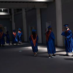 Seniors at Whitney M. Young Magnet High School head to line up for their graduation at Soldier Field on Wednesday, June 16, 2021.