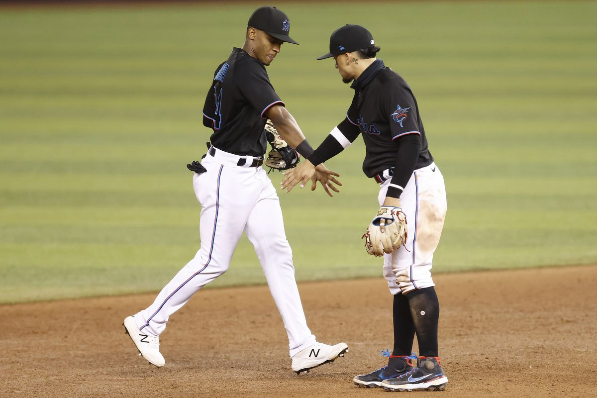Magneuris Sierra #34 of the Miami Marlins celebrates with Isan Diaz #1 after defeating the Milwaukee Brewers 6-1 at loanDepot park on May 07, 2021 in Miami, Florida.