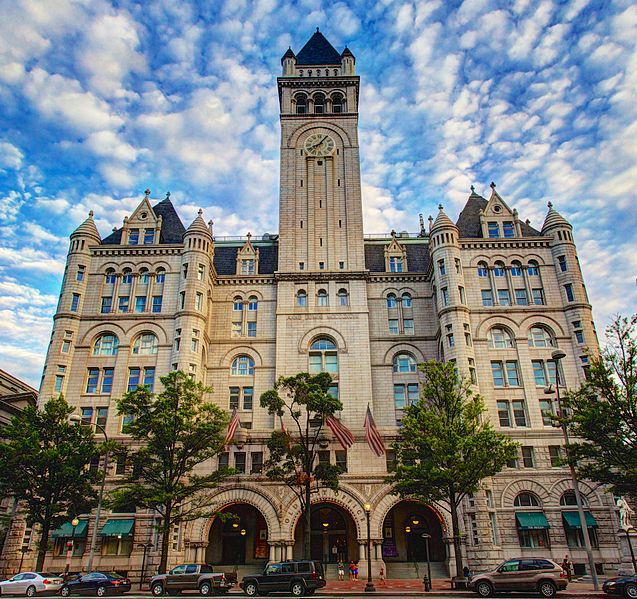 The facade of the Old Post Office Tower in Washington D.C. The exterior is tan and the building has one tower.