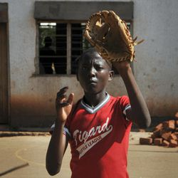 In this photo taken Wednesday, March 28, 2012, a pupil of the Rev. John Foundation school takes part in baseball training at the school in Kampala, Uganda. Unlike in most of Africa, soccer is not the top sport at the school in Uganda's capital - instead the fairly foreign American game of baseball is No. 1 and catching on quickly.