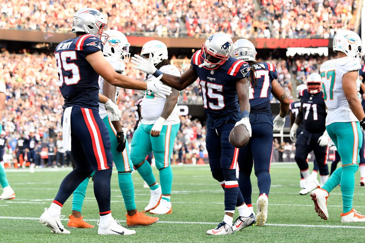 New England Patriots wide receiver Nelson Agholor (15) celebrates with New England Patriots tight end Hunter Henry (85) after scoring a touch down against the Miami Dolphins during the first half at Gillette Stadium.