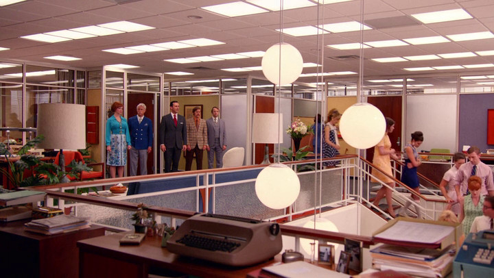 The staff exits, terrified for their jobs, on Mad Men.