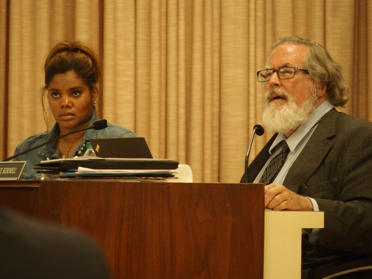 Board members Miska Clay Bibbs, left, and Mike Kernell listen to arguments during an appeal hearing for former Trezevant High School coach Teli White.