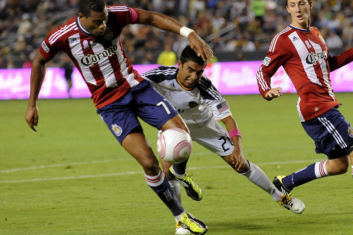 Chivas USA defender David Junior Lopes (77), of Brazil, manages to get the ball away from Los Angeles Galaxy defender A.J. DeLaGarza (20) during first half of an MLS soccer match, Sunday, Oct. 16, 2011, in Carson, Calif.