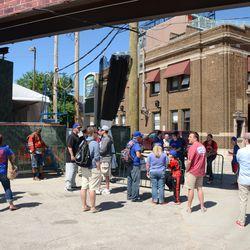 3:00 p.m. Fans lined up outside the players' parking lot on Waveland -
