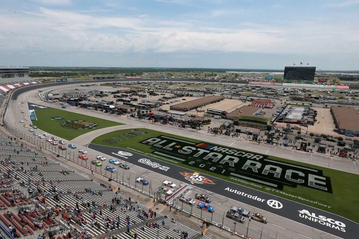 A general view of Ben Rhodes, driver of the #99 Bombardier LearJet 75 Toyota, and John Hunter Nemechek, driver of the #4 ROMCO Toyota, leading the field to start the NASCAR Camping World Truck Series SpeedyCash.com 220 at Texas Motor Speedway on June 12, 2021 in Fort Worth, Texas.