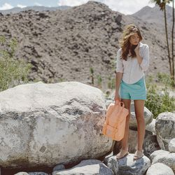 """Little America mid-volume backpack, <a href=""""http://shop.herschelsupply.com/collections/backpacks/products/little-america-backpack-flamingo-rubber"""">Herschel</a>, $39.99."""