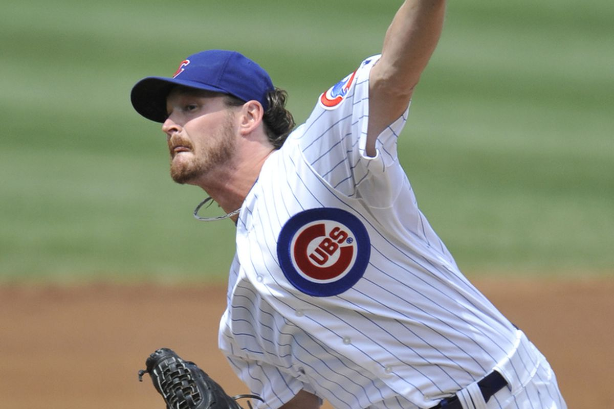 Starting pitcher Travis Wood of the Chicago Cubs delivers against the Houston Astros at Wrigley Field in Chicago, Illinois. (Photo by Brian Kersey/Getty Images)