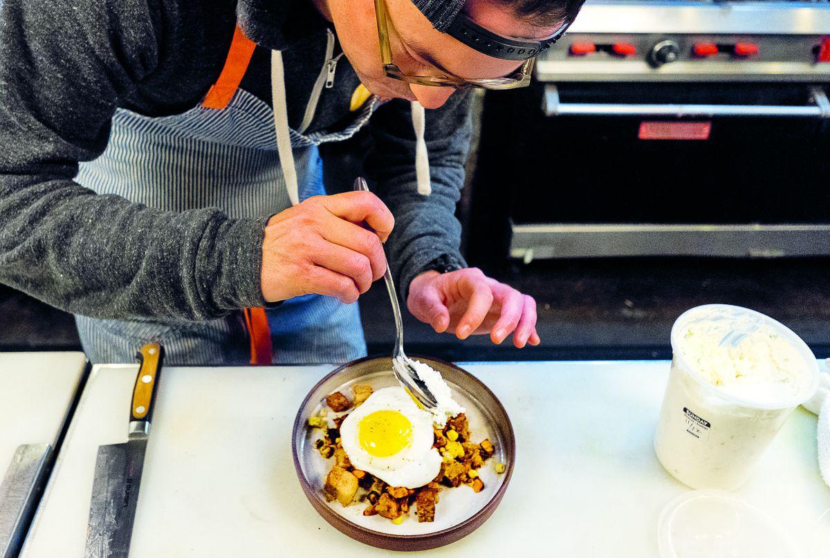 Eric Silverstein plating the brisket ham dish