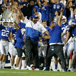 Brigham Young Cougars head coach Kalani Sitake and the rest of the BYU sideline begin to celebrate as they defeat Utah in an NCAA football game at LaVell Edwards Stadium in Provo on Saturday, Sept. 11, 2021. BYU won 27-16 ending a 9 game losing streak to the Utes.