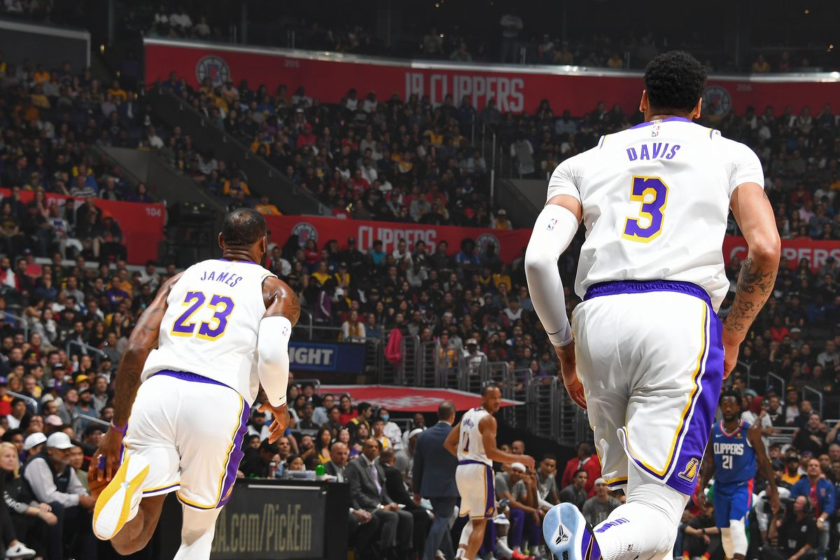 LeBron James of the Los Angeles Lakers and Anthony Davis of the Los Angeles Lakers run down the court during the game against the LA Clippers on March 8, 2020 at STAPLES Center in Los Angeles, California.